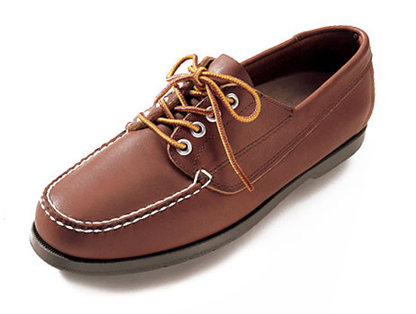 Valet looks at some moccasins
