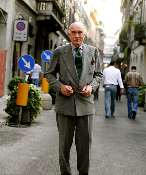 Luciano Barbera is pictured here with a green tie and grey suit