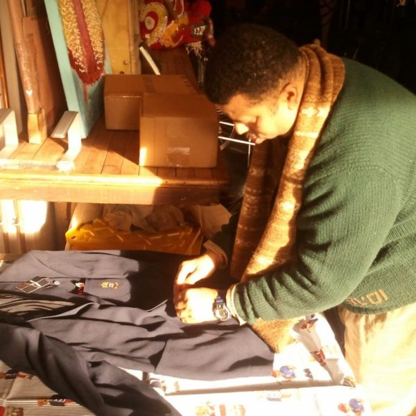 Dallas Penn adjusts a few of the 1000+ pieces in his Polo collection
