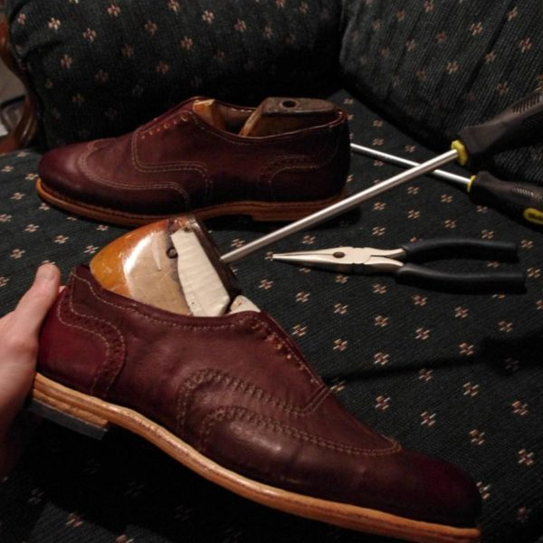 an enormous photo album documenting the process of making shoes by hand