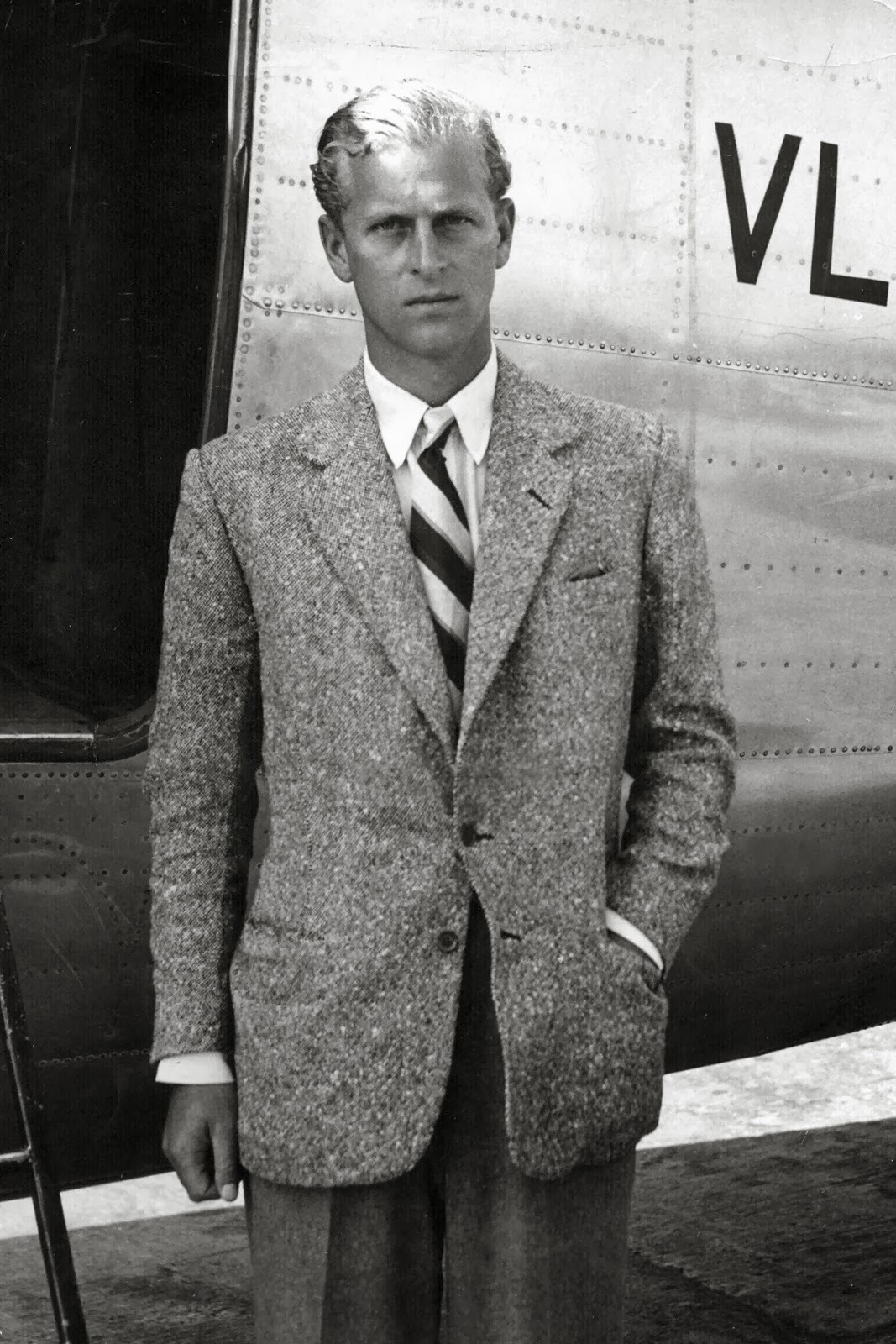 Prince Philip in contrasting textures and a block stripe necktie