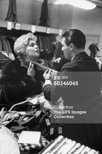 Kim Novak gets measured for a men's shirt