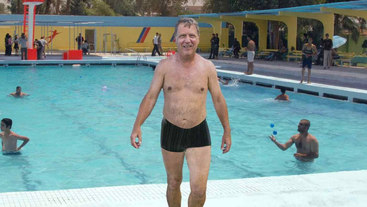 Man Wearing Low-Cut Swimsuit As Though Public Pool A Sun-Kissed Sardinian Cove